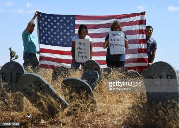 Members of the Southern California Healthcare Coalition protest beside tombstones they placed to highlight future deaths of those without health...