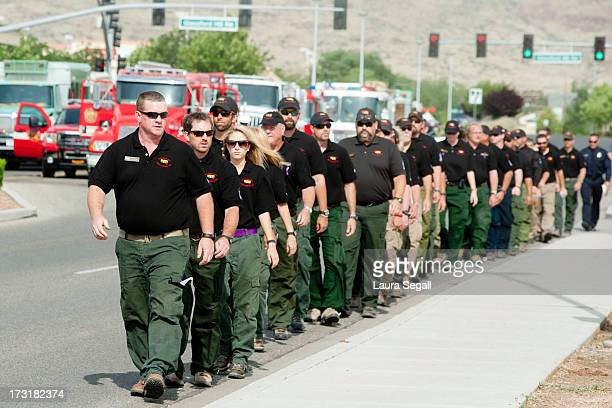Members of the Southwest Area Incident Management Team walk to the memorial service honoring the 19 firefighters killed in a wildfire at Tim's Toyota...
