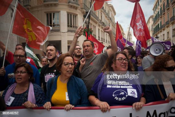 Members of the Spanish Comunist Party raise their fists as they take part in a demonstration during the May Day rally or Labour Day in Malaga...