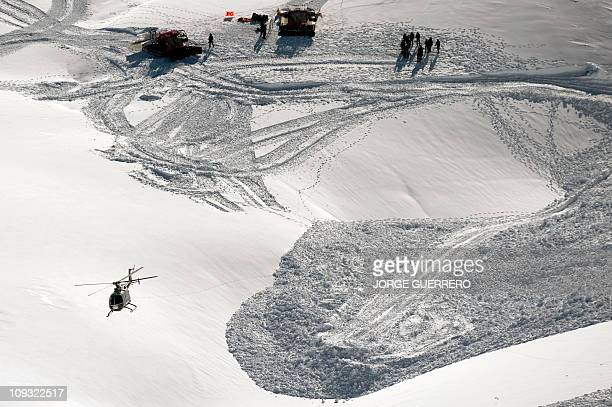 Members of the Spanish Guardia Civil look for a climber buried by an avalanche in San Juan Canyon next to the Sierra Nevada National Park on February...