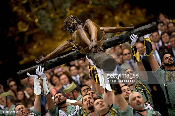 Members of the Spanish Legion carry a statue of the Christ of the Good Death to the Santo Domingo de Guzman Church during a Holy Week procession on...