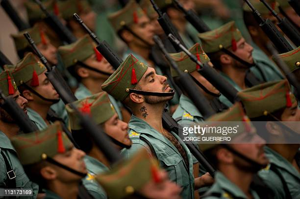 Members of the Spanish Legion match during a Holy Week procession on April 21 2011 in Malaga southern Spain Christian believers around the world mark...