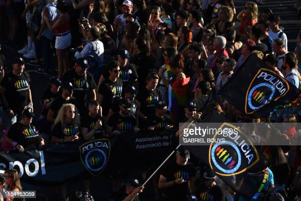 Members of the Spanish Police Lesbian Gay Bisexual Transgender Intersex and Queer community take part in the annual Pride parade in Madrid on July 6...