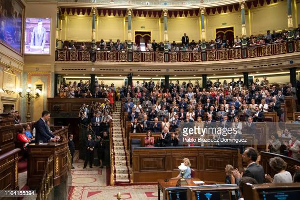 Members of the Spanish Socialist Party applause to acting Spanish Prime Minister Pedro Sanchez as he speaks during the third day of the investiture...