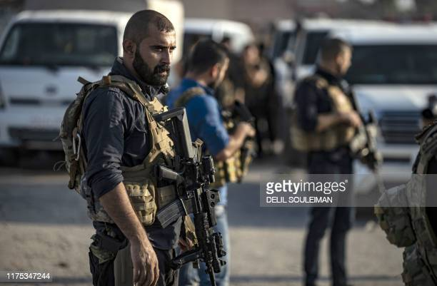 Members of the special forces of the Kurdishled Syrian Democratic Forces are pictured during preparations to join the front against Turkish forces on...