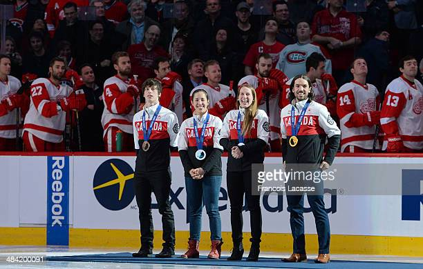 Members of the speed skating canada are honored with the singing of O' Canada before the start of the NHL game between the Montreal Canadiens and the...
