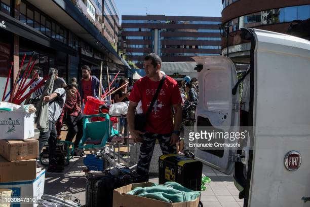 Members of the squat 'Aldo Dice 26 X 1' are forced to leave a former Alitalia office building on September 4 2018 in Sesto San Giovanni near Milan...