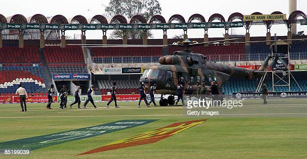 Members of the Sri Lankan international cricket team board a rescue helicopter at the Gadaffi Stadium on March 3, 2009 in Lahore, Pakistan. The team...