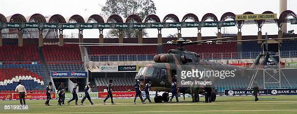 Members of the Sri Lankan international cricket team board a rescue helicopter at the Gadaffi Stadium on March 3 2009 in Lahore Pakistan The team...