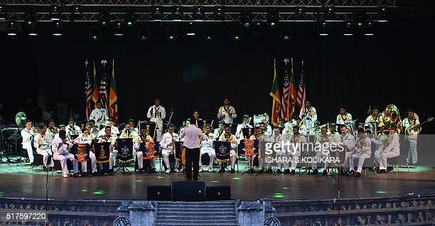 Members of the Sri Lankan Navy band and a US Navy band take part in a performance in Colombo on March 26, 2016. The USS Blue Ridge the command ship...
