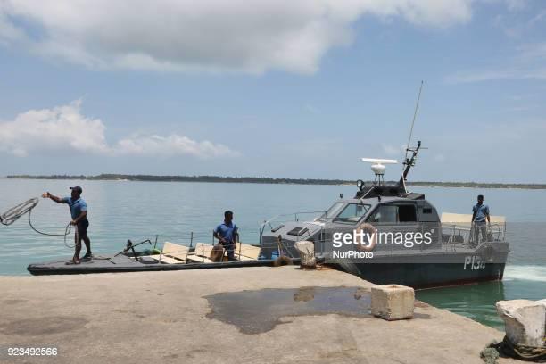 Members of the Sri Lankan Navy moor a naval boat at Kurikadduvan Harbour in Northern Sri Lanka