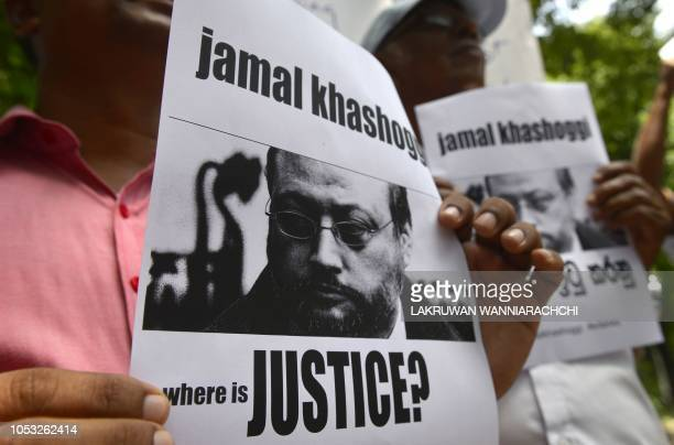 Members of the Sri Lankan web journalist association hold placards with the image of Saudi journalist Jamal Khashoggi during a demonstration outside...