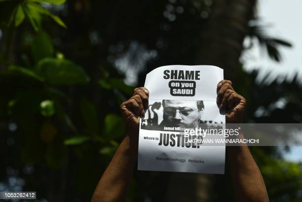 A members of the Sri Lankan web journalist association holds a placard with the image of Saudi journalist Jamal Khashoggi during a demonstration...