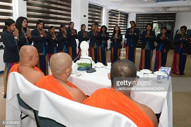 Members of the Sri Lankan women's cricket team players are blessed by Sri Lankan Buddhist monks in Colombo on March 8 2016 ahead of their departure...