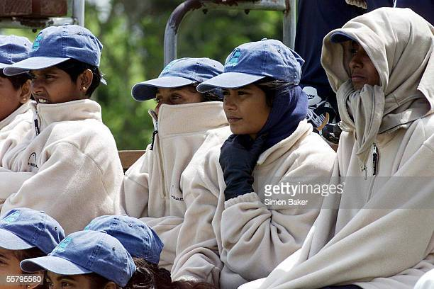 Members of the Sri Lankan womens cricket team wrap up for the cold southerly which blew during the first match of the CricInfo Womens World Cup...
