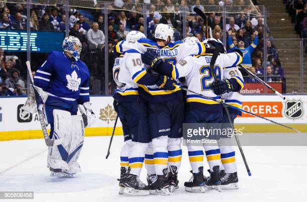 Members of the St Louis Blues celebrate a goal by Alexander Steen as Frederik Andersen of the Toronto Maple Leafs skates in his crease during the...