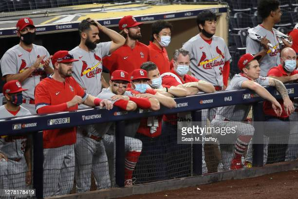 Members of the St. Louis Cardinals react to being down 4-0 during the ninth inning of Game Three of the National League Wild Card Series against the...