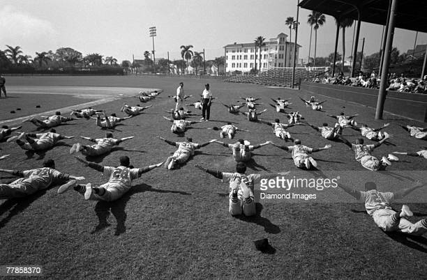 Members of the St Louis Cardinals stretch during Spring Training in March 1960 at Al Lang Field in St Petersburg Florida