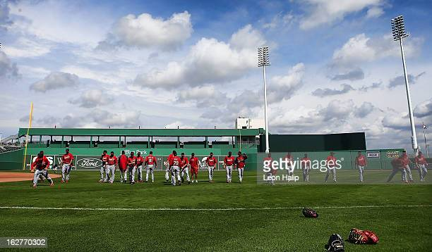 Members of the St Louis Cardinals warm up prior to the start of the game against the Boston Red Sox at JetBlue Park on February 26 2013 in Fort Myers...