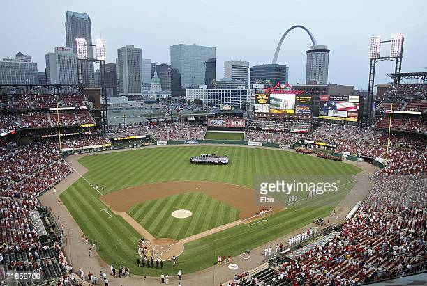 Members of the St. Louis police and fire departments display a U.S. Flag in center field as the national anthem is played on the fifth anniversary of...