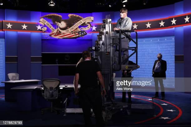 Members of the stage crew set up the debate hall ahead of the vice presidential debate in Kingsbury Hall of the University of Utah October 6, 2020 in...