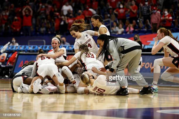 Members of the Stanford Cardinal celebrate a win against the Arizona Wildcats in the National Championship game of the 2021 NCAA Women's Basketball...