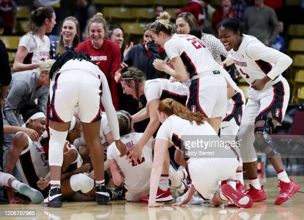 Members of the Stanford Cardinal celebrate after a buzzerbeating half court shot from Kiana Williams of the Stanford Cardinal to win the game between...