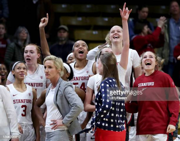 Members of the Stanford Cardinal celebrate on the bench after a buzzerbeating half court shot from Kiana Williams of the Stanford Cardinal to win the...