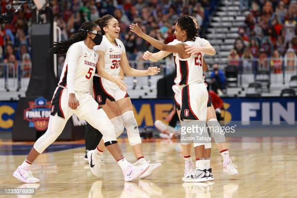 Members of the Stanford Cardinal celebrate the victory against the South Carolina Gamecocks in the semifinals of the NCAA Women's Basketball...
