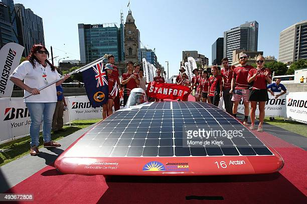 Members of the Stanford Solar Car Project team celebrate after finishing the 2015 Bridgestone World Solar Challenge at Victoria Square on October 22,...