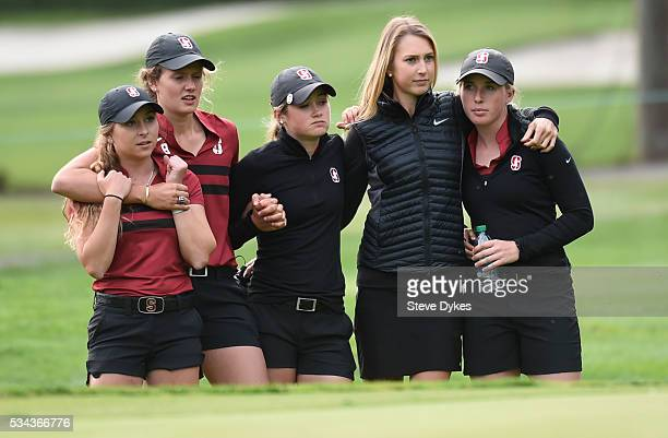 Members of the Stanford team look on from the edge of the 18th hole during the final round of the 2016 NCAA Division I Women's Golf Championship...
