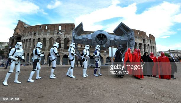 Members of the Star Wars fan club celebrate 'Star Wars Day' in front of the Colosseum in central Rome on May 4 2014 AFP PHOTO / TIZIANA FABI