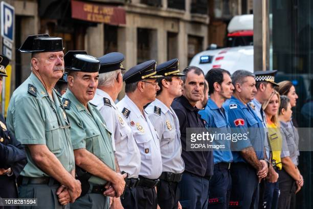 Members of the state security bodies firefighters sanitation teams are seen in formation during the event Barcelona celebrated the first anniversary...