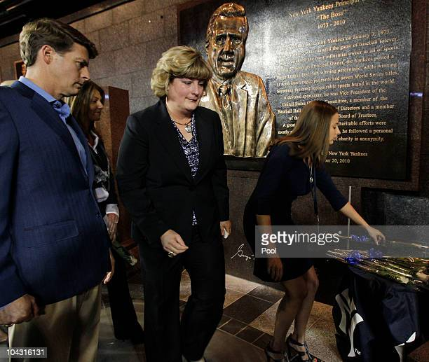 Members of the Steinbrenner family Hal Steinbrenner and Jessica Steinbrenner pass by their father's monument following as another member of the...
