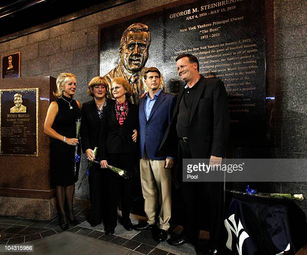 Members of the Steinbrenner family pose for photographers following a ceremony dedicating a monument to the late Yankees principal owner George...