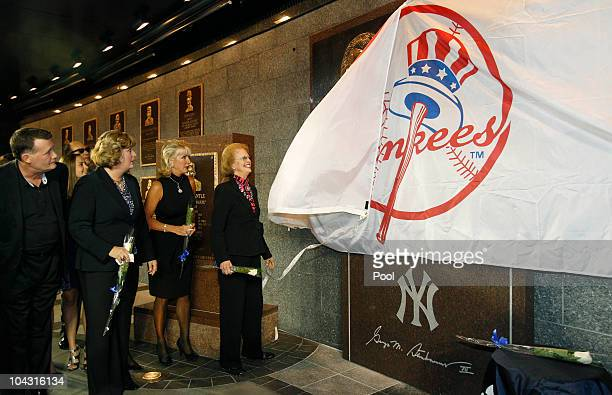 Members of the Steinbrenner family watch as Steinbrenner's widow Joan pulls a Yankees banner down to reveal a monument to the late Yankees principal...