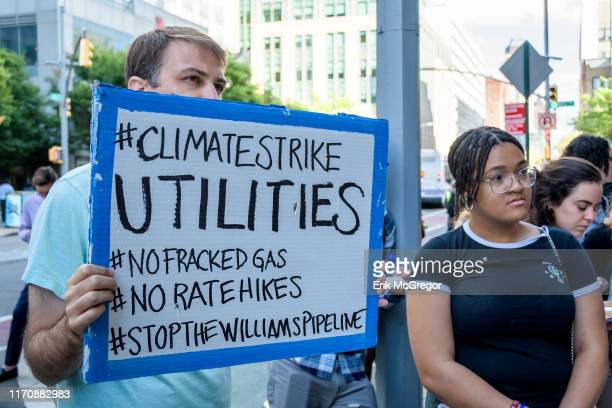 Members of the Stop the Williams Pipeline Coalition gathered for a press conference holding signs and banners outside National Grid Corporate...