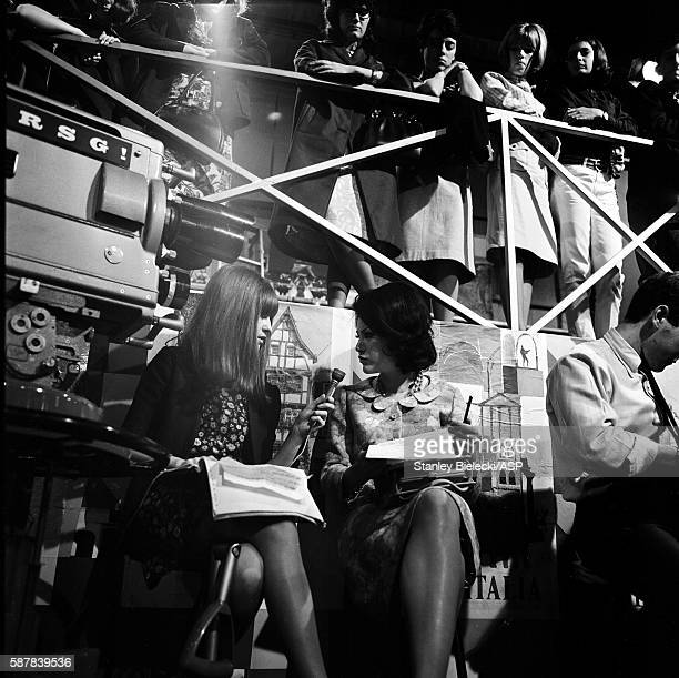 Members of the studio audience watch as a cameramen films presenter Cathy McGowan on the TV show Ready Steady Go Wembley Studios London 1965