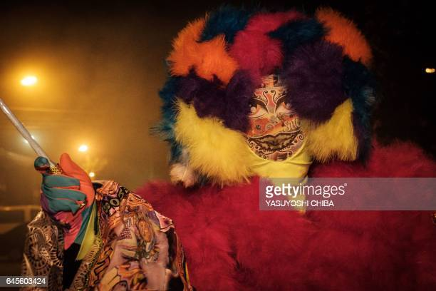 """Members of the """"Sucesso"""" bate-bola street carnival band parade during the first day of carnival in Rio de Janeiro, Brazil, on February 25, 2017. The..."""