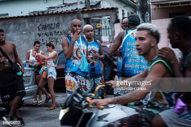 Members of the Sucesso batebola street carnival band relax before parading during the first day of carnival in Rio de Janeiro Brazil on February 25...