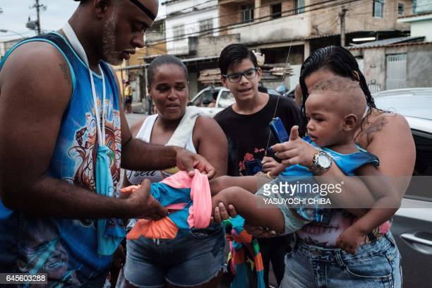 """Members of the """"Sucesso"""" bate-bola street carnival band relax before parading during the first day of carnival in Rio de Janeiro, Brazil, on February..."""