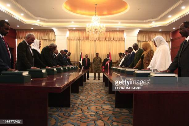 Members of the Sudanese cabinet take oath in the presence of the new Prime Minister Abdalla Hamdok and General Abdel Fattah alBurhan the head of...
