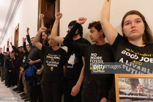 Members of The Sunrise Movement stands outside the Senator Mitch McConnell's office on Monday morning during a rally in favor of the Green New Deal...