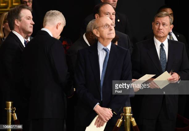 Members of the Supreme Court Brett Kavanaugh , Neil Gorsuch , Stephen Breyer, and John Roberts wait for the casket containing the remains of former...
