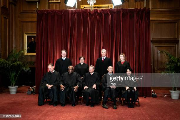 Members of the Supreme Court pose for a group photo at the Supreme Court in Washington, DC on April 23, 2021. Seated from left: Associate Justice...