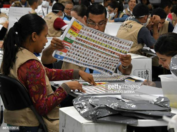 Members of the Supreme Electoral Tribunal count deputies' votes in Tegucigalpa on December 06, 2017. Honduras appeared set for a recount of its...