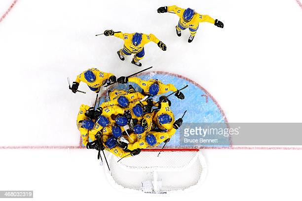 Members of the Sweden ice hockey team celebrate their 1-0 win over Japan during the Women's Ice Hockey Preliminary Round Group B Game on day two of...