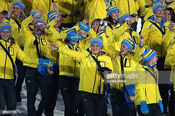 Members of the Swedish Olympic team wave to the crowd during the Opening Ceremony of the 2010 Vancouver Winter Olympics at BC Place on February 12...