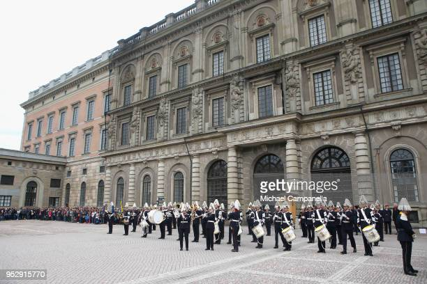 Members of the Swedish Royal Marching Band perform during a celebration of King Carl Gustav's 72nd birthday anniversary at the Royal Palace on April...