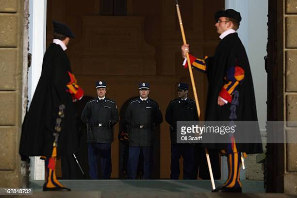 Members of the Swiss Guard prepare to close the doors to Pope Benedict XVI's residence in Castel Gandolfo and transfer responsibility for his...